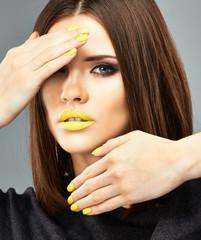 Yellow nails and lips. Beauty woman