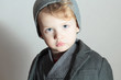 Winter Style Little Boy in cap.Stylish Child. Fashion Kids