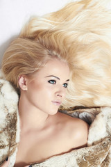 sexy Beautiful blond woman in fur coat.winter style.pretty girl
