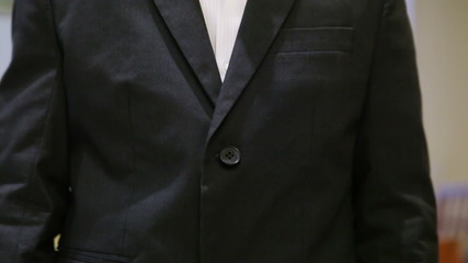 Fastening buttons on  jacket