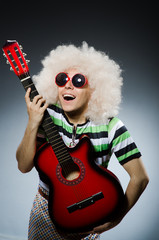 man with funny haircut and guitar