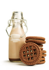 chocolate milk in a bottle with cookies
