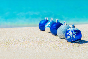 Christmas tree decorations on sea sandy beach