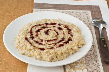 Oat porridge with bilberry jam