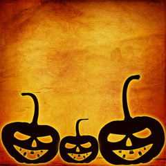 Festive pumpkin Halloween Day on the abstract paper background