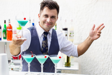 barman with cocktail drink