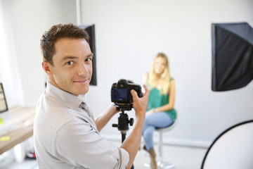 Fashion photographer at work in studio