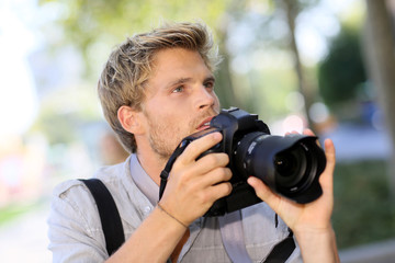 Photographer shooting outside with digital camera