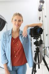 Cheerful training girl in photo studio