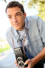 Photographer using vintage camera