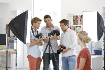 Class of photography in studio with model