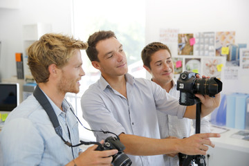 Photographer with students in training class