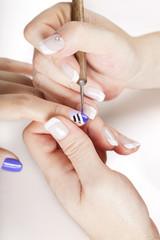 Nail salon.Applying nail art. close up