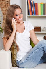 Portrait of a beautiful young woman talking on the phone
