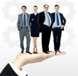 Group of business people standing on palm