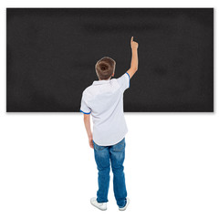 Student pointing on blank chalkboard