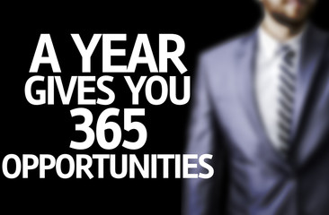 A year Gives You 365 Opportunities written on a board