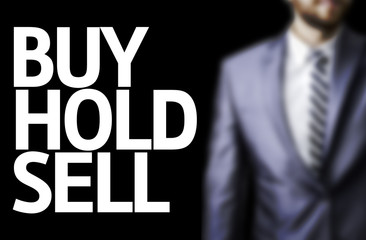 Buy Hold Sell written on a board