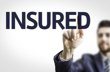 Business man pointing to transparent board with text: Insured