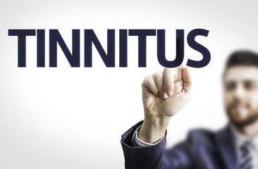 Business man pointing the text: Tinnitus