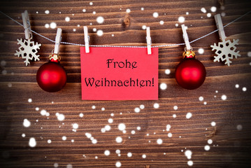 Frohe Weihnachten on a Red Banner in the Snow