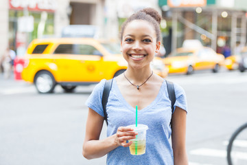 Beautiful Young Woman with Refreshing Drink in New York
