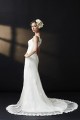 Elegant young bride in wedding dress, studio shot.