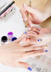 Nail gel salon.Applying nail art.