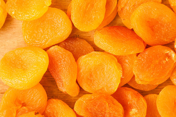 Heap of dried apricots close-up food background