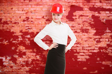 Female engineer woman architect in red safety helmet