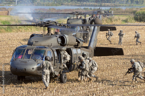 Soldiers boarding helicopter