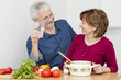 Happiness mature couple in the kitchen