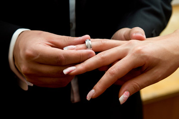 Couple exchanges rings during wedding ceremony.