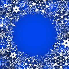 Festive winter frame with ornate snowflakes