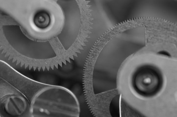 Black white background with metal cogwheels a clockwork