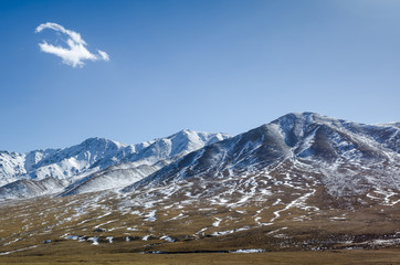 Beautiful snowy Tibetan high mountain landscape with the lonely