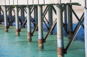 Closeup detail of metal pier supports