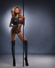 Fashion shoot of a young sexy striptease dancer