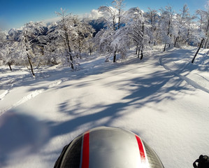 Skiing in fresh snow. POV using action cam on the helmet
