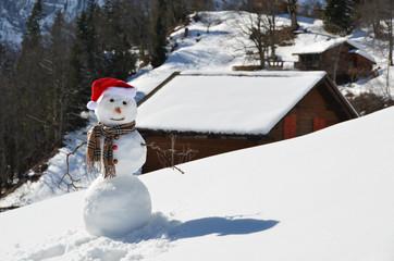 Snowman against Alpine panorama