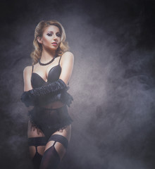 Attractive young woman in sexy lingerie over vintage background