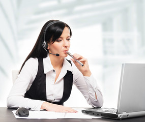 Young and attractive business woman with an electronic cigarette