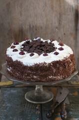 Chocolate cherry cake with whipped cream