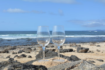 Two Glasses Of  Wine On The Tropical Beach