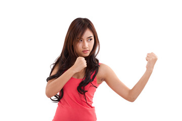 portrait of female fighter, boxer punching pose