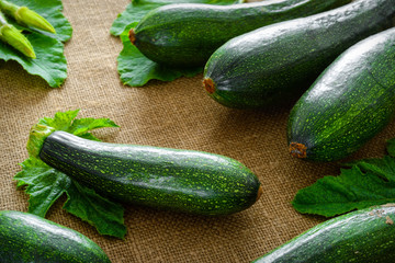 Fresh organic zucchini on fabric background