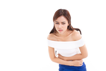 woman suffers from menstruation pain or stomach ache