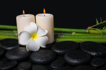 spa concept of zen basalt stones, white flower frangipani, candl