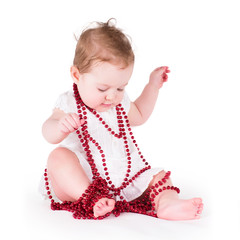 Girl playing with red pearls