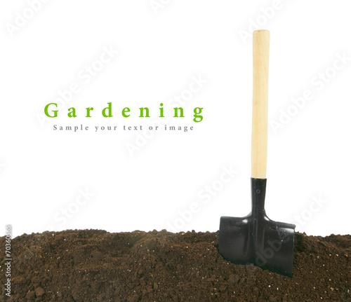 Fotobehang Tuin Gardening. A shovel in earth.